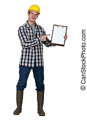 Construction worker pointing to a blank clipboard