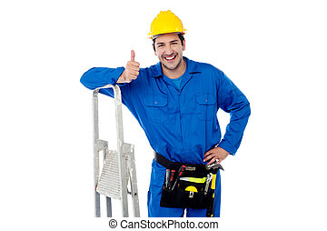 Construction worker posing with step ladder