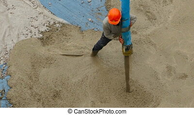 Worker Pouring concrete mortar - Construction Worker Pouring...