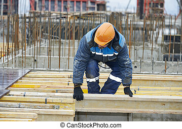 construction worker preparing formwork - construction worker...