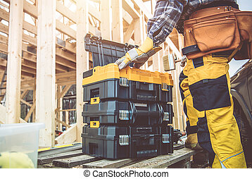 Construction Worker Preparing His Toolboxes