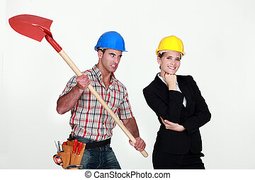Construction worker preparing to hit an engineer over the...