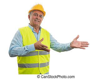 Construction worker presenting copyspace