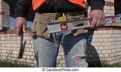 Construction worker put hammer in