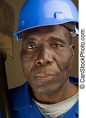 Construction Worker Resting Shovel on Shoulder