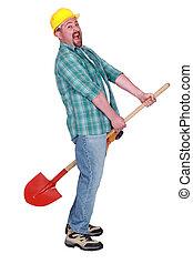 Construction worker riding a shovel