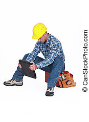 Construction worker sat on his tool box