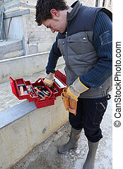 Construction worker selecting tool