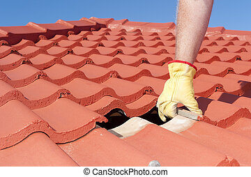 Construction worker shingle roofing repair