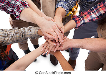 Construction worker stacking hands - Large group of...