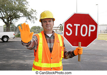 Construction Worker Stop - A construction worker holding a ...
