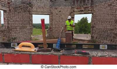 Construction worker take sledge hammer