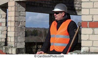 Construction worker take sledgehamm
