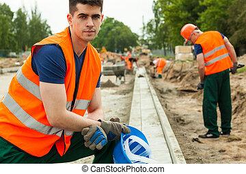 Construction worker taking break