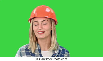 Construction worker talking to camera on a Green Screen, Chroma Key.