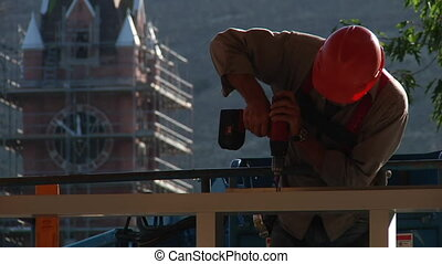 construction worker uses drill