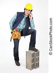 Construction worker using a cellphone