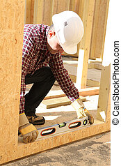 Construction worker using a spirit level