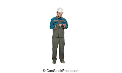 Construction worker using cell phone to send message on white background.
