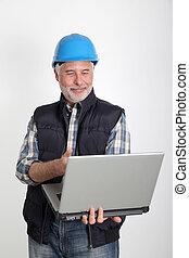 Construction worker using laptop computer