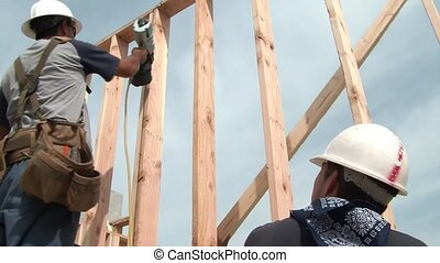 Construction Worker Using Nail Gun & Hammering