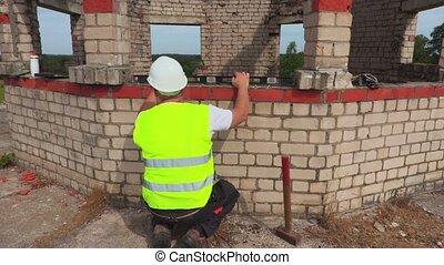 Construction worker using spirit level