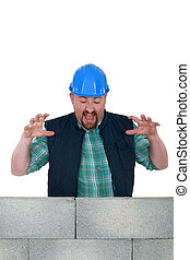 Construction worker with a block wall