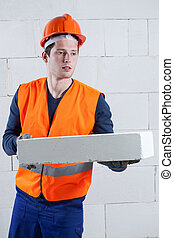 Construction worker with a brick