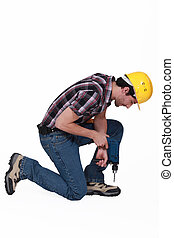 Construction worker with a cordless drill