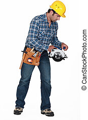 Construction worker with a disc cutter