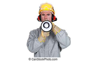 Construction worker with a loudspeaker