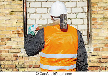 Construction worker with a sledgeha