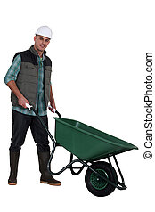 Construction worker with a wheelbarrow
