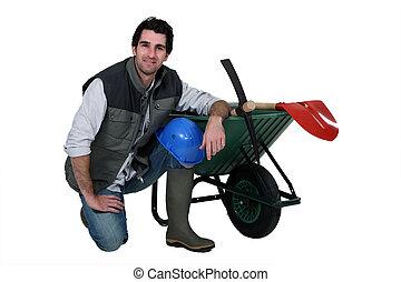 Construction worker with a wheelbarrow