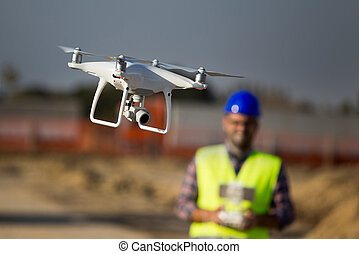 Construction worker with drone at building site - Close up ...