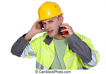 Construction worker with earmuffs