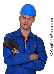 construction worker with folded arms holding wallet