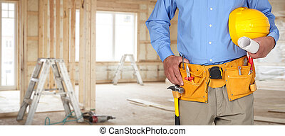 Construction worker with helmet and tool belt. -...