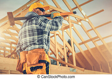 Construction Worker with Large Hammer