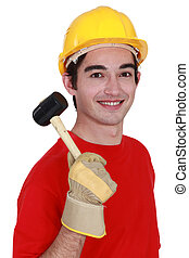 Construction worker with mallet