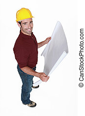 Construction worker with map in hand
