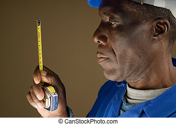 Construction Worker with Measuring