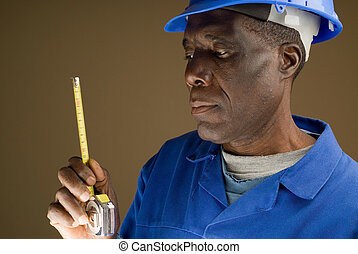 Construction Worker with Measuring Tool