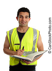 Construction worker with pen and book - A male construction...