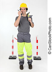 Construction worker with radio receiver