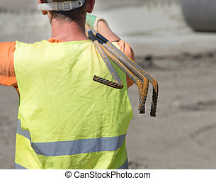 Construction worker with reinforcement rods