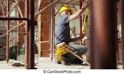 Construction worker with tablet pc