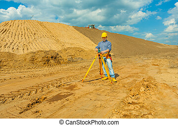 construction worker with theodolite