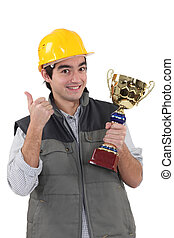 Construction worker with trophy