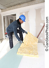 Construction worker with wall insulation